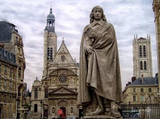 Statua di Blaise Pascal, Parigi. Dietro la statua si scorge la bella chiesa di Saint-Etienne-du-Mont, dove riposano i resti del filosofo, nei pressi del Pantheon.